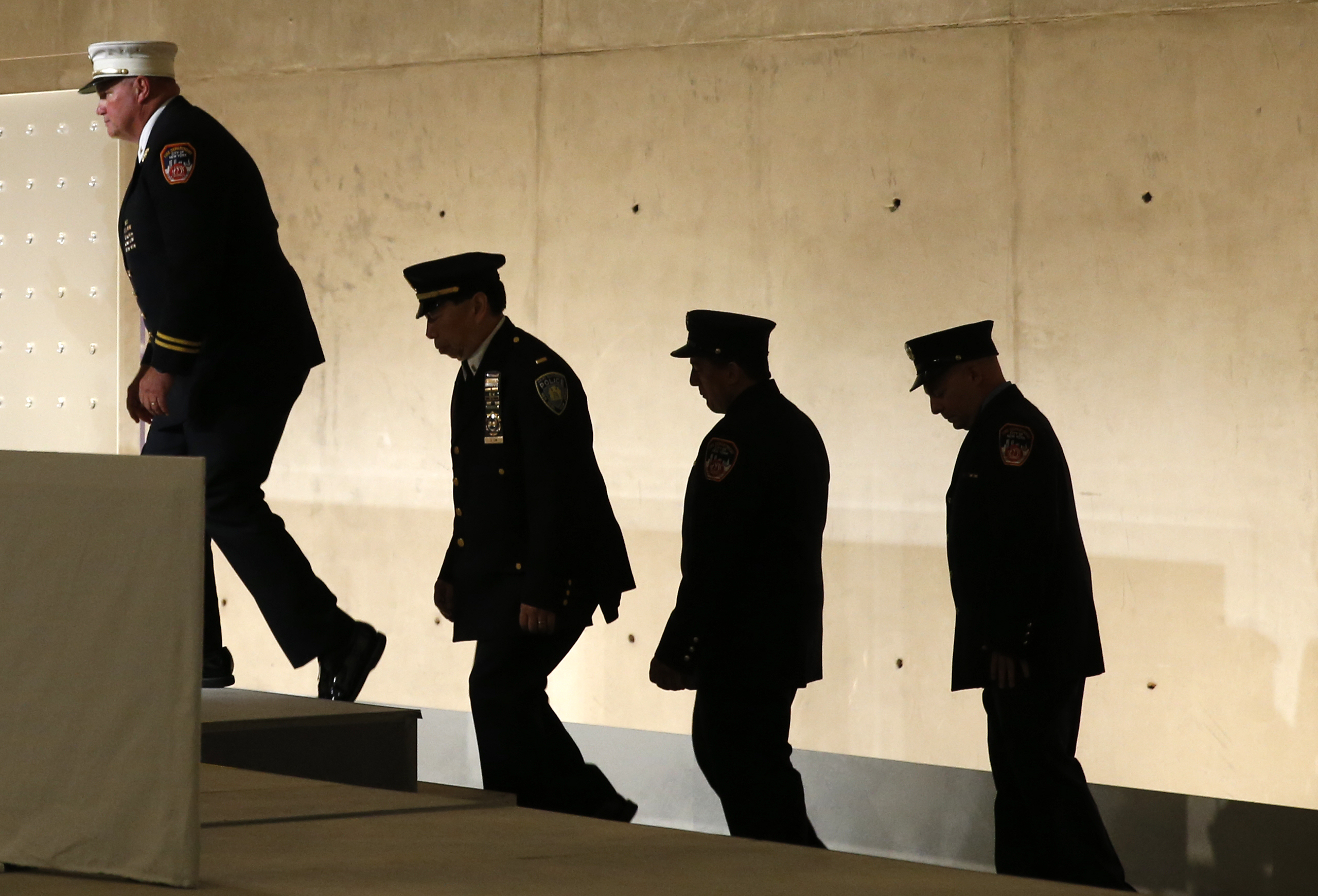 First responders step onto the stage (Mike Segar/REUTERS)