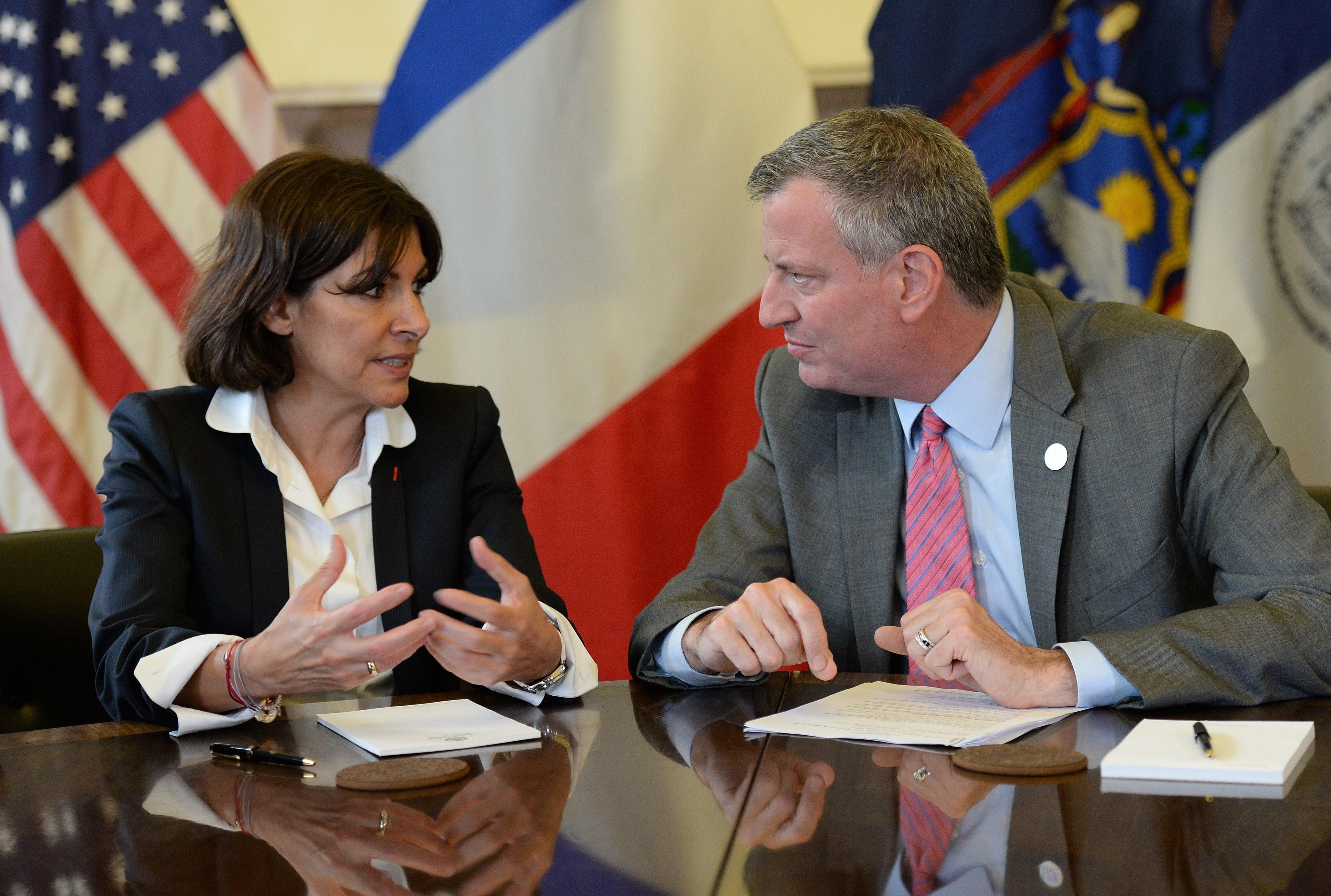 Mayor Bill de Blasio bonds with Paris Mayor Anne Hidalgo. (Photo: EMMANUEL DUNAND/AFP/Getty)