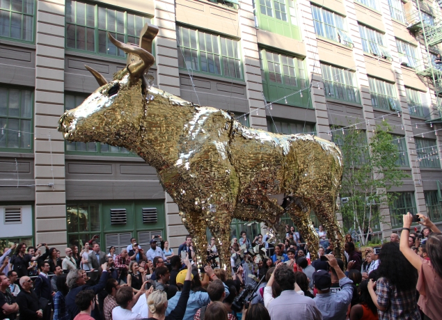 Participants opened artist Sebastian Errazuriz's cash filled cow piñata. (Meredith Carey)