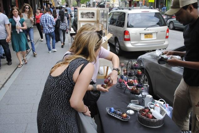 A street vendor sells egg shell plant holders.
