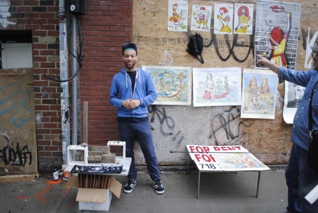 "A vendor uses a ""For Rent"" sign to set up shop."