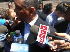 Councilman Ruben Wills in a media scrum.