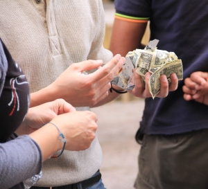Scrambling for one dollar bills, some participants came away with over $50. (Meredith Carey)