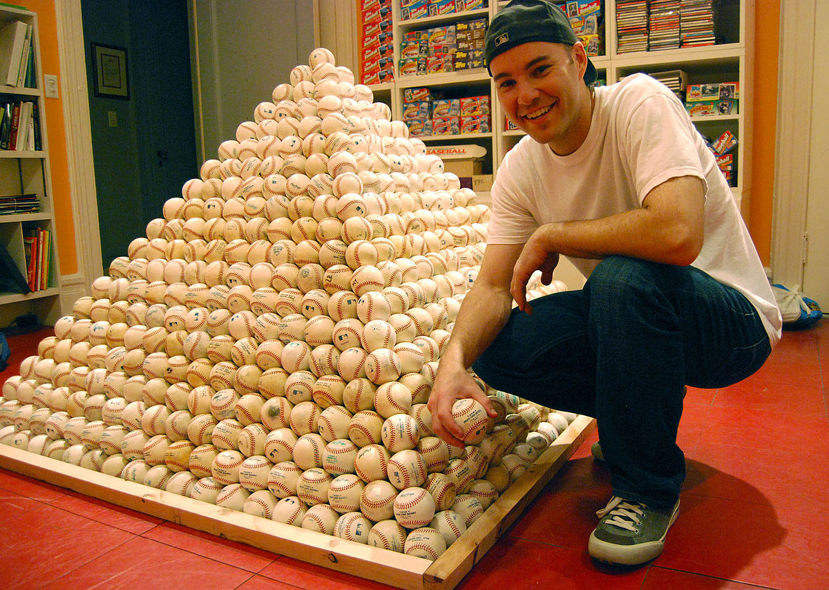 Zack Hample with a fraction of his collection (Wikimedia Commons)