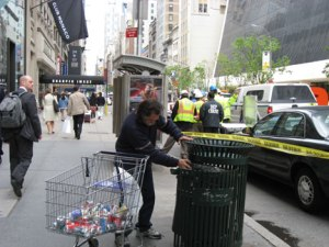 A canner collecting recyclables from a garbage can in NYC. (essygie/Flickr)