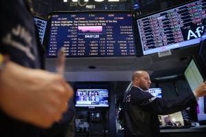 Traders work on the floor of the New York Stock Exchange. (Photo via Spencer Platt/Getty Images)