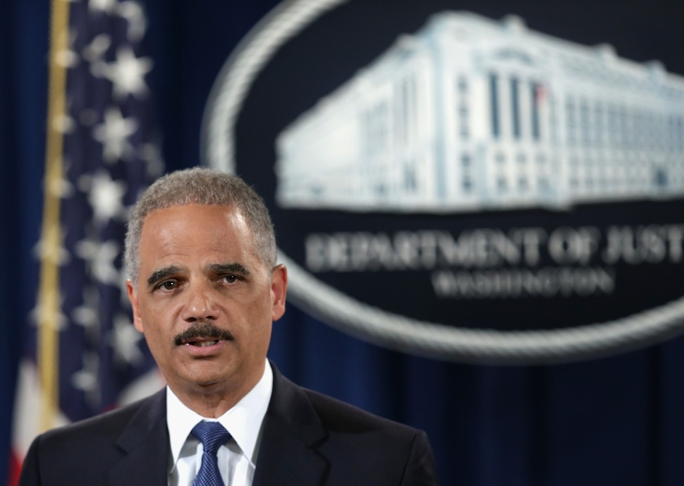 Attorney General Eric Holder has systematically consolidated the power and authority of the Department of Justice, opposing calls for reform. (Getty Images)