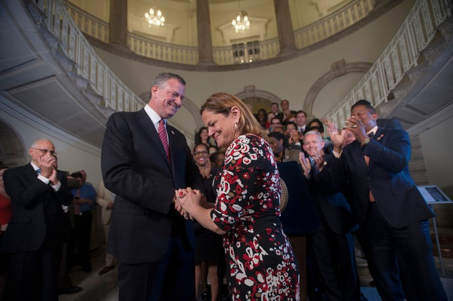 Mayor Bill de Blasio and Council Speaker Melissa Mark-Viverito share a moment after announcing a budget deal. (Photo: William Alatriste for the New York City Council)