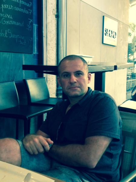 The author at a café in Cannes