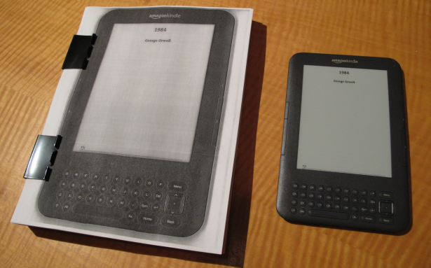 On the right is a Kindle displaying a book. On the left is a book displaying that Kindle displaying a book. (Photo via Jesse England)