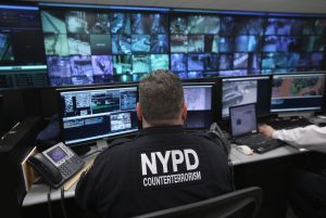 An NYPD officer watches security camera footage during the Bloomberg era. (Photo by John Moore/Getty Images)
