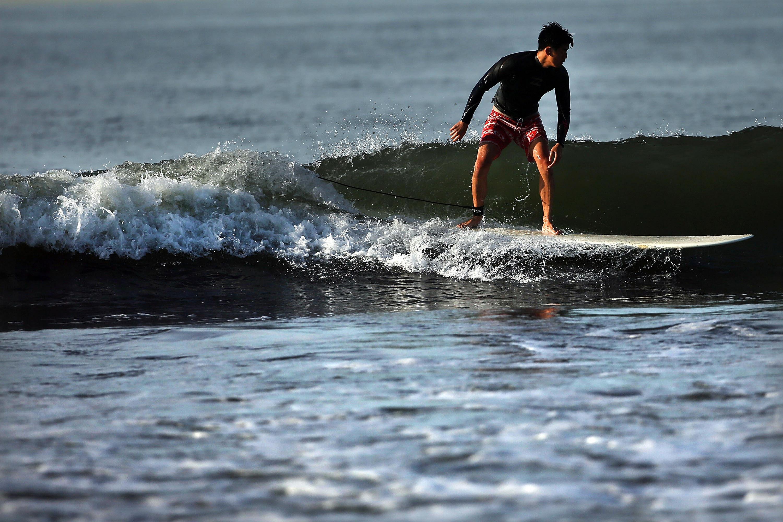 A Surfer on Rockaway Beach.