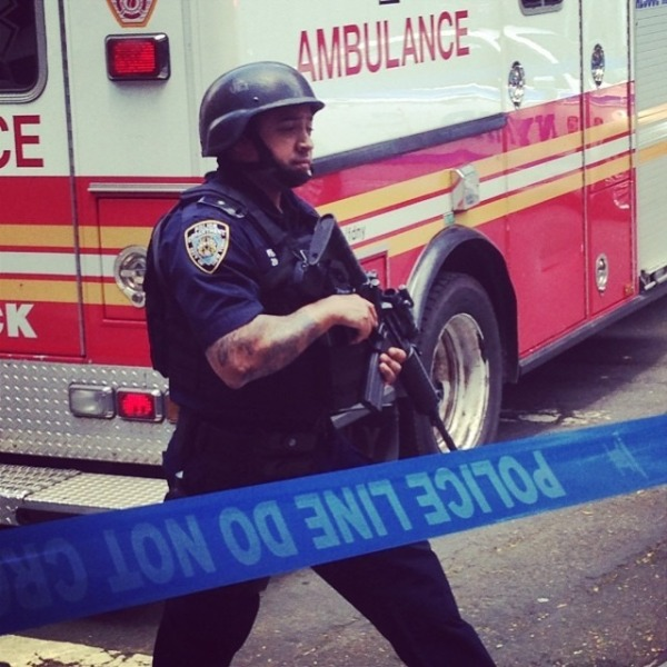 NYPD officer at the scene of the shooting. (Alexis Green/Instagram)