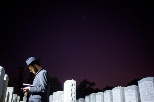 A visitor prays at the gravesite of the Rebbe, Rabbi Menachem Mendel Schneerson. (Photo via Getty Images)