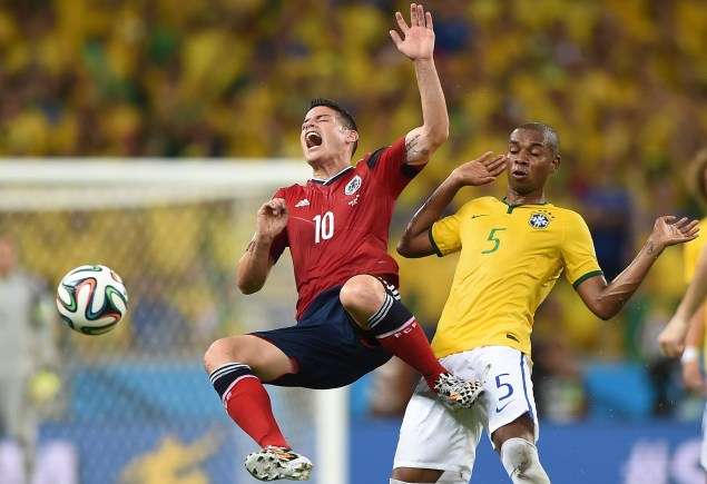 Colombia's James Rodriguez vies with Brazil's Fernandinho (Photo via Getty Images)