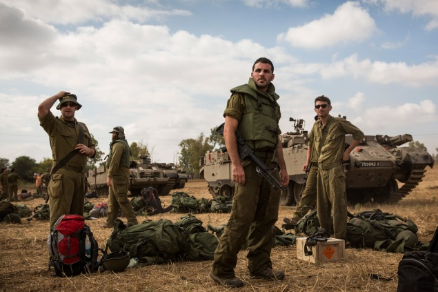 Israeli reservists troops arrive for duty near the Israel-Gaza border. (Photo via Getty Images)