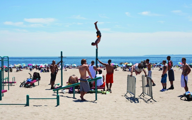 Waterfront acrobatics on the Coney Island beach. (Celeste Sloman)