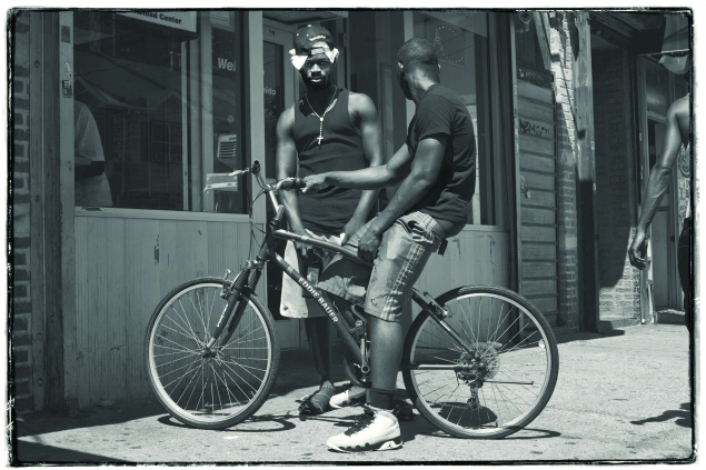 Young men passing time on the street in Coney Island. (Celeste Sloman)