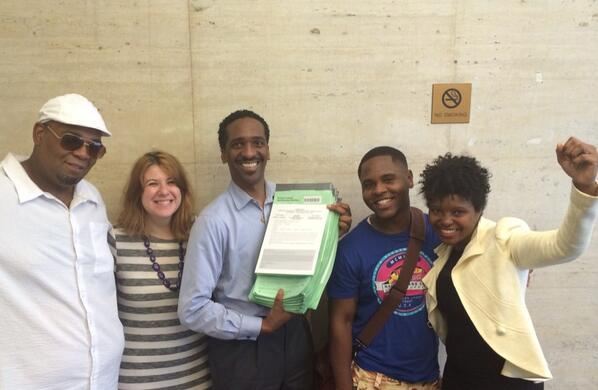 Rubain Dorancy shows off his ballot petitions with supporters.  (Photo: Twitter/@RubainDorancy)