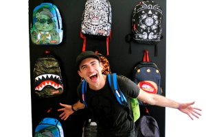 David Ben-David, creative director of Sprayground, in his showroom. Behind him are some of this season's bags. (Photo: Matt Mullen)