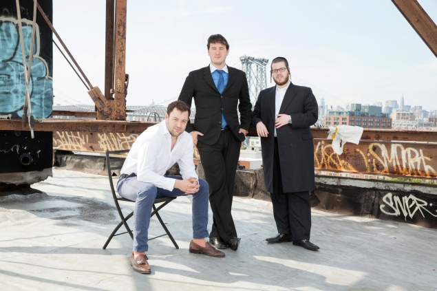EXR founders Mario Faggiano, John Le Vine and Sam Rubin atop a building in Williamsburg. (EXR Group)