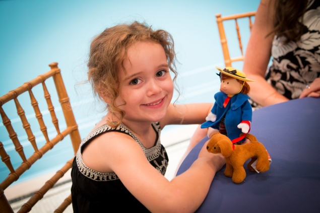 A girl with her Madeline doll at the special preview held last night. (Kaitlyn Flannagan)