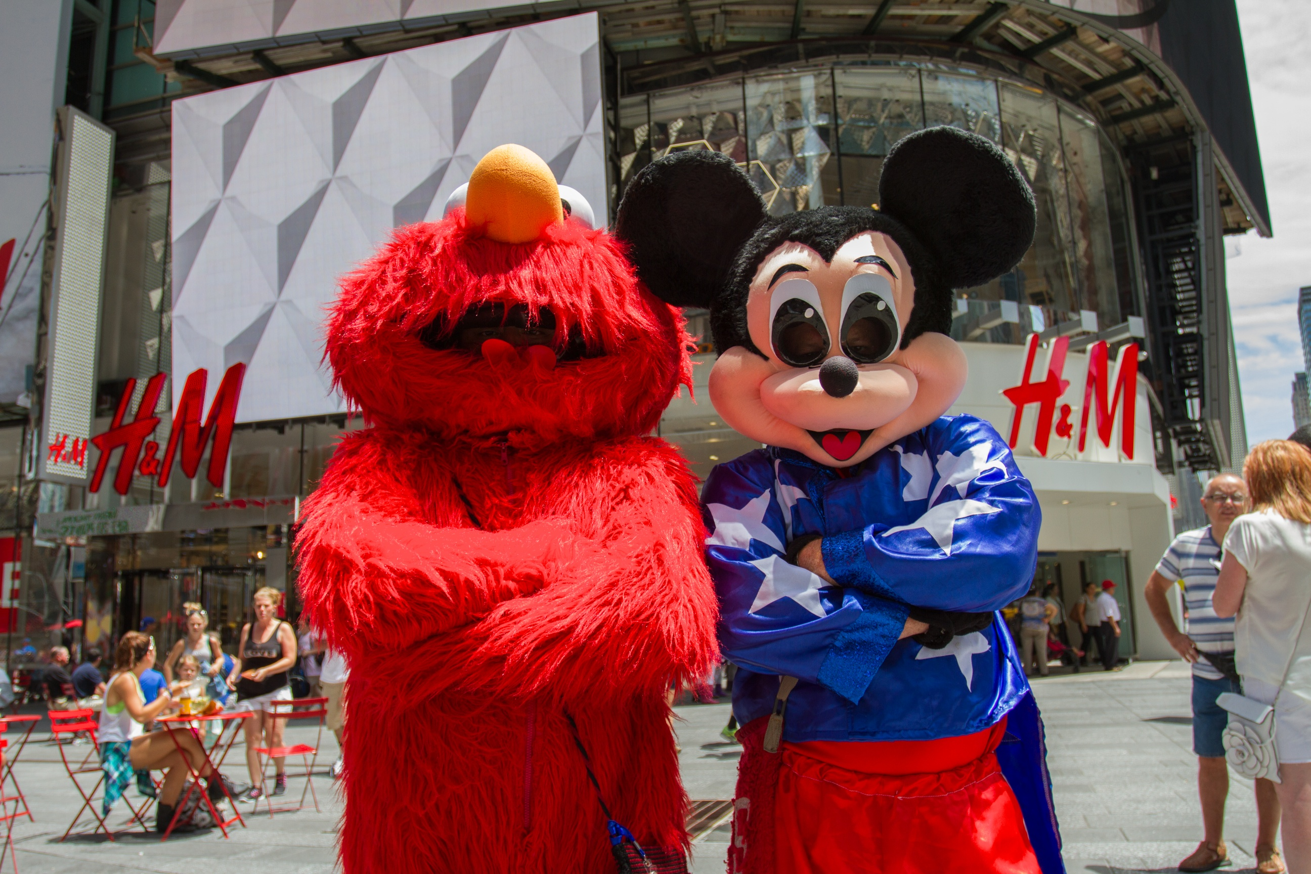 (Photo by Daniel Cole)The Mickey Mouse on the right refused to lift his mask for the photo. He told the Observer that he his kids are in Columbia and they don't know this is what he does for a living.