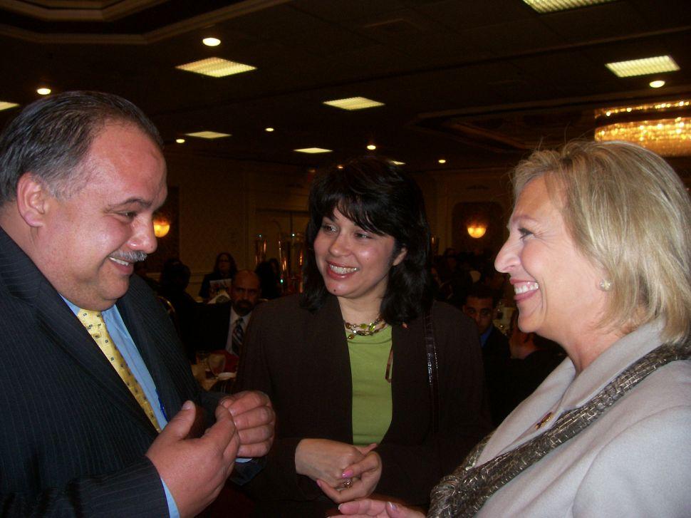 Huttle, right, with veteran Newark Councilman Luis Quintana.