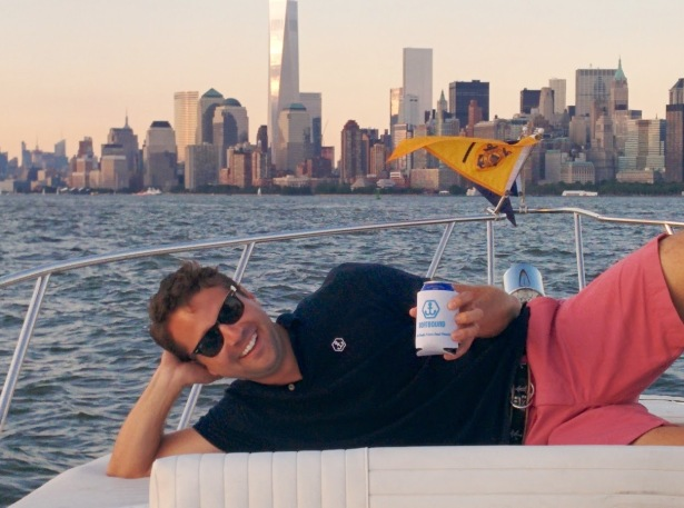 A Boatbound founder enjoyed himself on the bow during last week's press tour. (Photo via Boatbound)