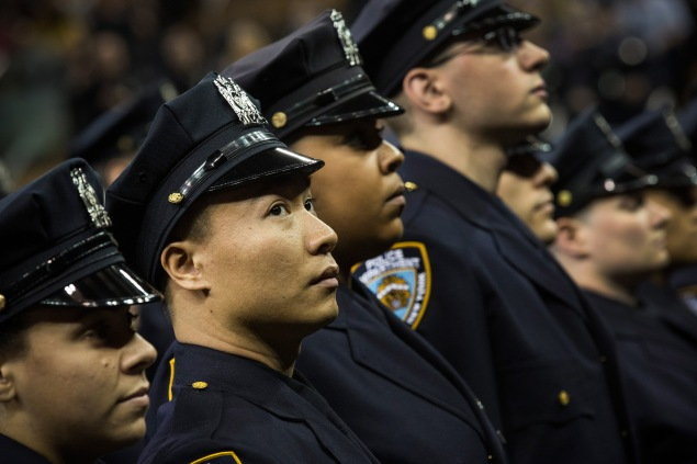Members of a 2014 class of the New York Police Department. (Photo by Andrew Burton/Getty Images)