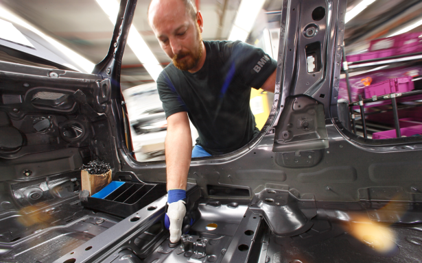 The thumbs are custom made for workers for the singular purpose of pushing down this rubber cap. (Photo via BMW)