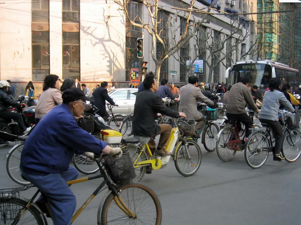 We bet all these Shanghai cyclists wish their bikes could do the biking for them. (Wikimedia Commons)