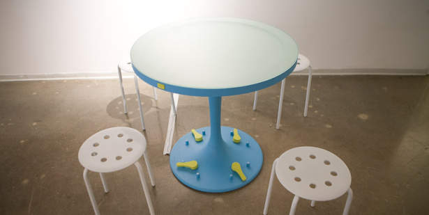 "Ms. McCarthy's ""Relatable"" is a table that has footpedels so that you can indicate your declining interest in someone's small-talk. The table will flash a distress beacon if the conversation becomes too intolerable. (Photo via Lauren McCarthy)"