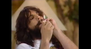 Rev. Bud Green lighting up on an episode of the Joan Rivers Show. (YouTube)