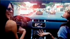 She's definitely not looking at the road. (Screengrab: Perez Hilton)