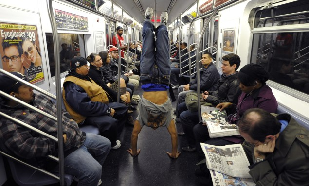 Dancing on the train cars is illegal, but many buskers feel unsafe from the NYPD on the platforms. (Getty)