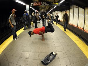 A subway performer dancing on a platform. (Getty)