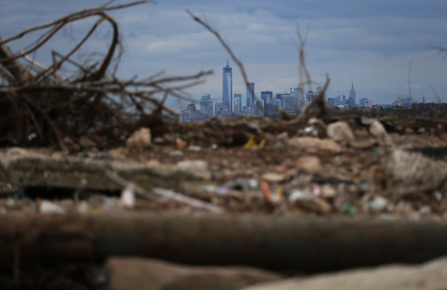 A flood-damaged beach covered by debris in the aftermath of Hurricane Sandy, taken a year after the storm. (Photo:  Mario Tama/Getty Images).
