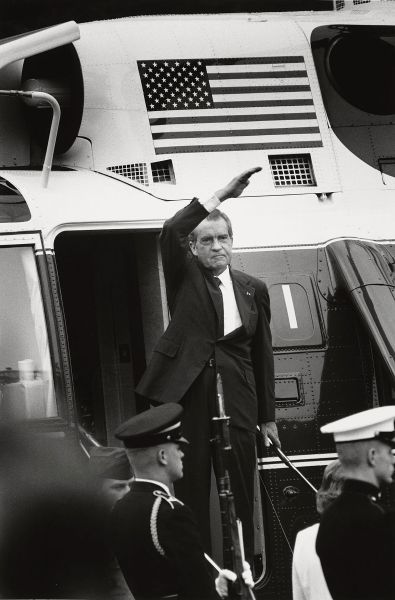 Richard Nixon stands on the steps of the presidential helicopter as he waves goodbye. (Photo by David Hume Kennerly)