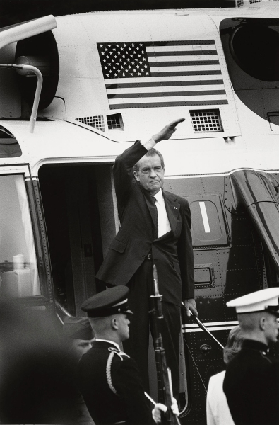 President Richard Nixon stands on the steps of the presidential helicopter as he waves goodbye. (Photo by David Hume Kennerly)