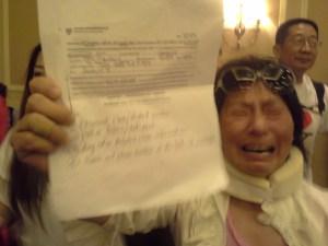 A sobbing woman interrupts the Queens forum.