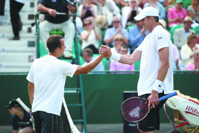 Germany's Philipp Kohlschreiber is a full foot shorter than Isner. (Photo by Jordan Mansfield/Getty Images)