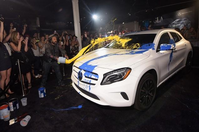 Artist Mr Brainwash paints a car. (Photo via Getty Images)