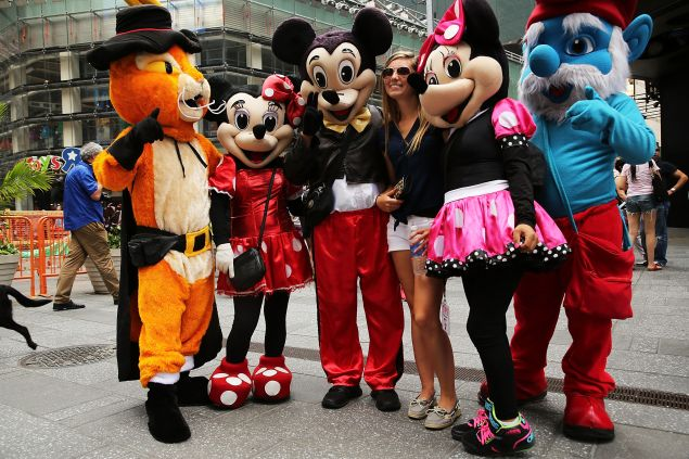 We shall not be moved: Times Square costumed characters pose for a picture. (Getty)