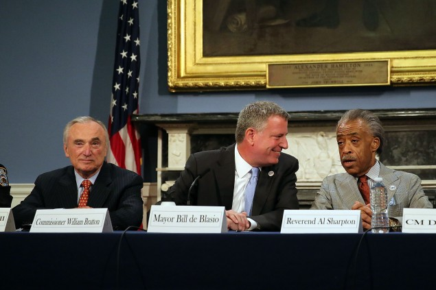 Mayor Bill de Blasio, center, with Commissioner Bill Bratton and Rev. Al Sharpton (Photo by Spencer Platt/Getty Images).