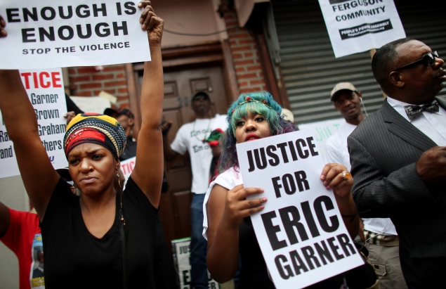 People attend a rally against police violence on August 23 in Staten Island (Photo by Yana Paskova/Getty Images).