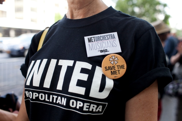 Members of The Met Orchestra' Union Local 802, AFM rally across the street from Lincoln Center to remove the the threat of a lockout and extend negotiations until an agreement is reached with Opera managers. Photo by Aaron Adler/For New york observer