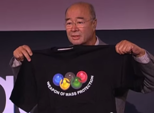 This wasn't the only condom T-shirt he brought to the talk. (Screengrab: YouTube)