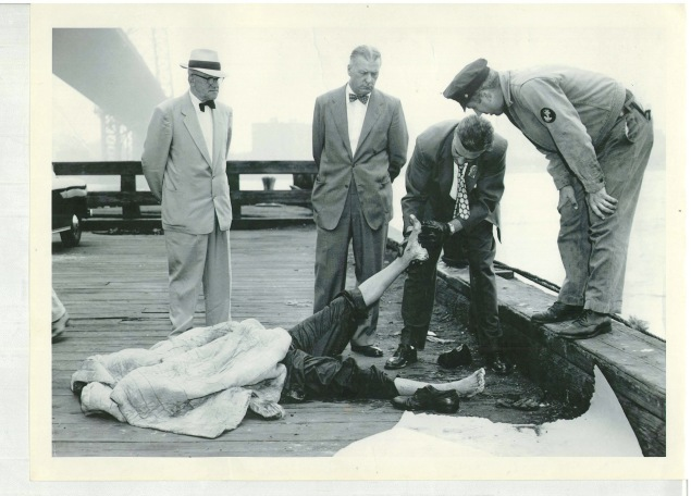 Commissioner Kennedy and Inspector Thomas Nielson watch detectives examine the body of Willie Menter