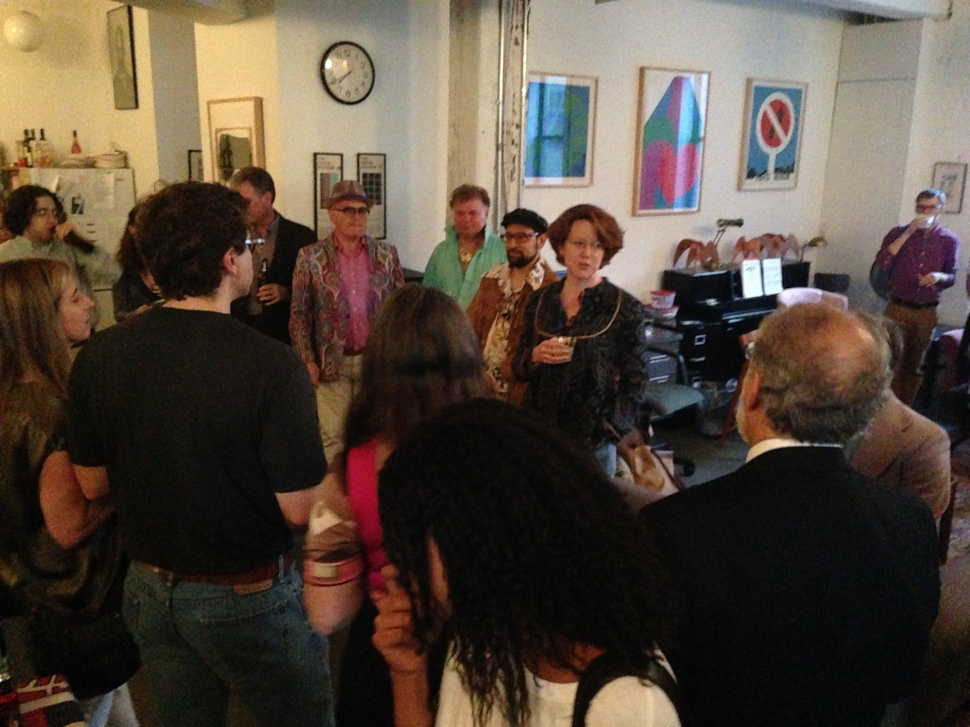 Literary agent Tina Bennett toasts author Rick Perlstein at the Chelsea office of The Paris Review